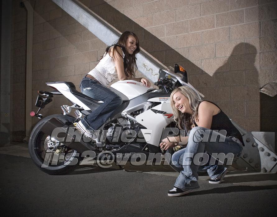 Blonde and Brunette on Aprilia Sport Bike